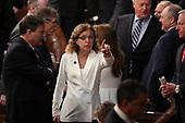 United States Representative Debbie Wasserman-Schultz (Democrat of Florida) points towards the gallery from the floor prior to US President Donald J. Trump delivering his second annual State of the Union Address to a joint session of the US Congress in the US Capitol in Washington, DC on Tuesday, February 5, 2019.  She is wearing white in response to Representative Lois Frankel's call to acknowledge the voters who handed Democrats a majority in the House in the midterm elections and a reminder that they plan to make women's economic security a priority.<br /> Credit: Alex Edelman / CNP