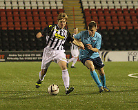 Barry Cuddihy fends off Lewis Spence in the St Mirren v Dunfermline Athletic Scottish Professional Football League Under 20 match played at the Excelsior Stadium, Airdrie on 11.12.13.