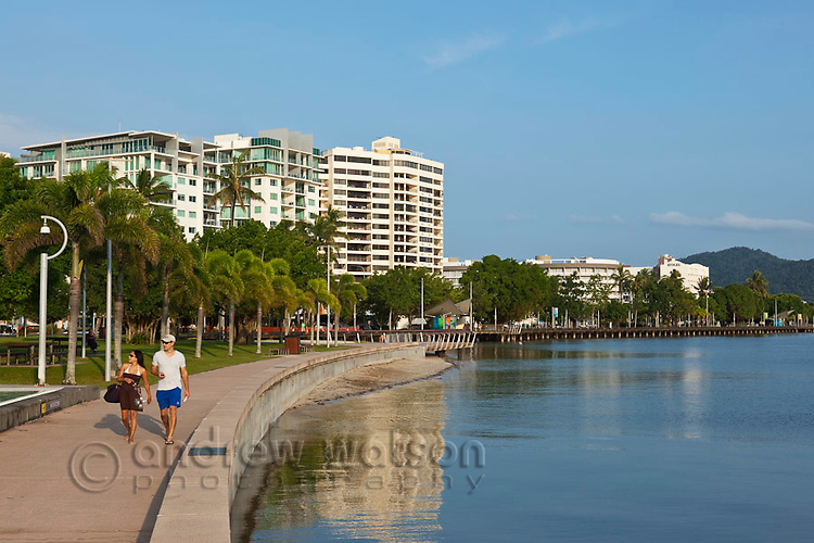 Couple walking along the Esplanade beside the Lagoon.  Cairns, Queensland, AUSTRALIA