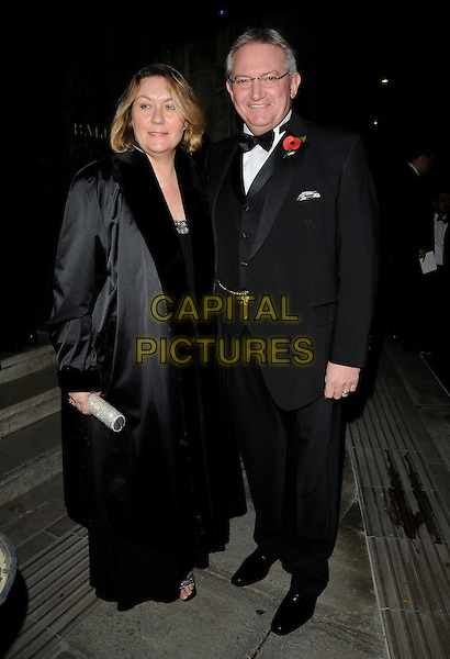 GUEST & GRAHAM COLE .At the Marion Rose Ball, Grosvenor House hotel, London, England, UK, November 13th 2010..full length black suit tie white shirt bow tuxedo tux coat poppy glasses .CAP/CAN.©Can Nguyen/Capital Pictures.
