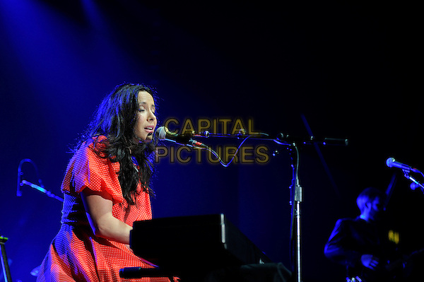 Nerina Pallot <br /> performing in concert, LG Arena, Birmingham, England, UK, <br /> 21st September 2013.<br /> music live on stage gig half length singing microphone keyboard red dress  side playing <br /> CAP/MAR<br /> &copy; Martin Harris/Capital Pictures