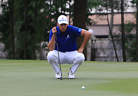 Rafa Cabrera Bello (Europe) on the 15th green during the Singles Matches of the Eurasia Cup at Glenmarie Golf and Country Club on the Sunday 14th January 2018.<br /> Picture:  Thos Caffrey / www.golffile.ie