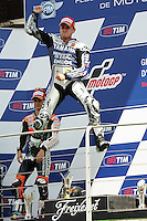 15.07.2012. Mugello, Italy. MotoGP Motorcycle Grand prix, Mugello, Italy.Podium picture shows Jorge Lorenzo (winner) jumping for joy with Dani Pedrosa and Andrea Dovizioso (3rd)
