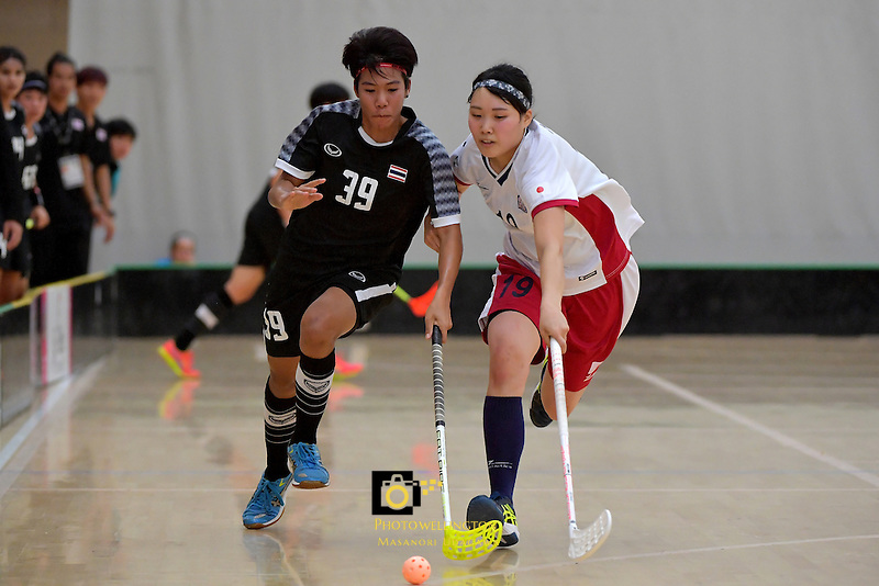 Thailand's Pichawee Yoola and Japan's Kaede Hiashi in action during the World Floorball Championships 2017 Qualification for Asia Oceania Region - Japan v Thailand at ASB Sports Centre , Wellington, New Zealand on Saturday 4 February 2017.<br /> Photo by Masanori Udagawa<br /> www.photowellington.photoshelter.com.