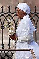 Cuba, Havana.  Woman Practitioner of Santeria entering Church of La Merced.