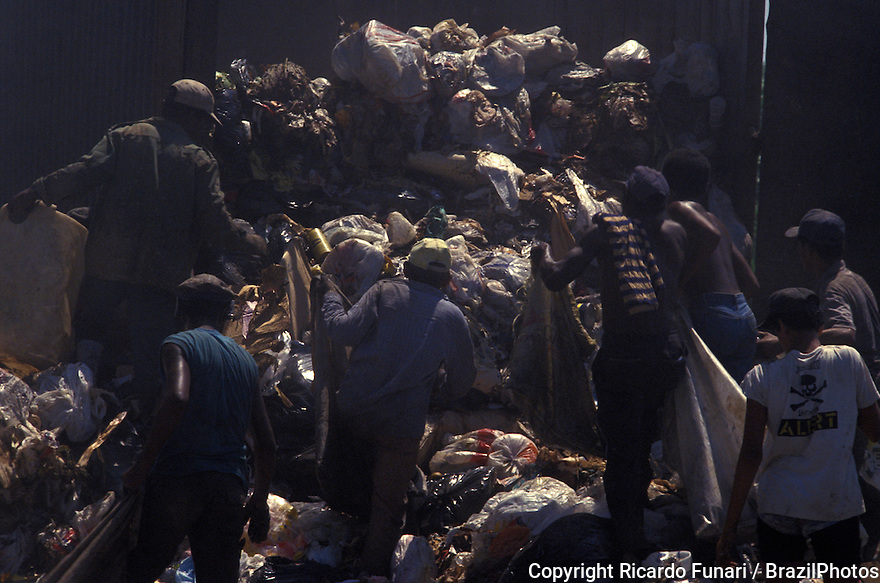 Pickers sort through garbage finding recyclables as a means of survival at Metropolitan Landfill of Jardim Gramacho (  Aterro Metropolitano de Jardim Gramacho ) in Duque de Caxias city, one of the largest landfills in the world, closed in June 2012 after 34 years of operation when it received most of the garbage produced in Rio de Janeiro city - it was started on an ecologically-sensitive wetland in the 1970s adjacent to Guanabara Bay.