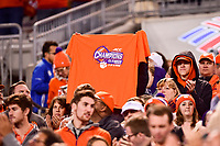 Charlotte, NC - DEC 2, 2017: A Clemson Tigers fan holds up a 3 time Championship t-shirt during ACC Championship game between Miami and Clemson at Bank of America Stadium Charlotte, North Carolina. (Photo by Phil Peters/Media Images International)