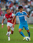 Kieran Gibbs of Arsenal FC and Lo Kwan Yee of Kitchee in action during the pre-season Asian Tour friendly match at the Hong Kong Stadium on July 29, 2012. Photo by Victor Fraile / The Power of Sport Images