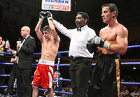 Stephen Smith (Liverpool, red shorts) defeats Zsolt Nagy (Hungary, black/gold shorts) in a Featherweight boxing contest at York Hall, Bethnal Green, promoted by Frank Warren / Sports Network - 22/05/09 - MANDATORY CREDIT: Gavin Ellis/TGSPHOTO - Self billing applies where appropriate - 0845 094 6026 - contact@tgsphoto.co.uk - NO UNPAID USE.
