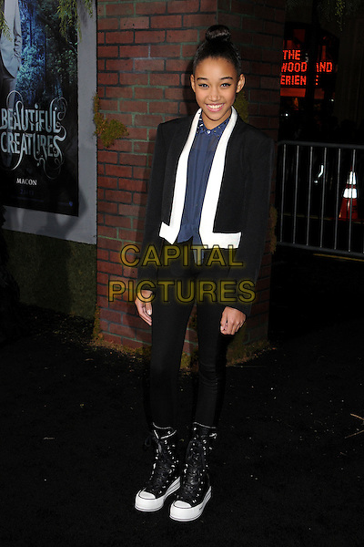"Amandla Stenberg.""Beautiful Creatures"" Los Angeles Premiere held at the TCL Chinese Theatre, Hollywood, California, USA. .February 6th, 2013.full length black blue white shirt jeans denim trainers sneakers studs studded collar hair up bun .CAP/ADM/BP.©Byron Purvis/AdMedia/Capital Pictures."