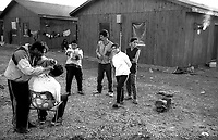 Montenegro in November 2000.<br /> Refugee camp Konik 1.<br /> The barber Gio, 30 years married with a wife and two children, was a barber in Italy in Naples returned to Kosovo to marry has been blocked because of the war, now for a haircut takes a euro, must earn at least &euro; 1,600 to pay to smugglers and return to Italy.<br /> <br /> Montenegro Novembre 2000.<br /> Campo profughi di Konik 1.<br /> Il barbiere Gio, 30 anni sposato con moglie e due figli, era barbiere in Italia a Napoli tornato in Kosovo per sposarsi &egrave; rimasto bloccato per via della guerra, adesso per un taglio di capelli prende un euro, deve guadagnare almeno  &euro; 1600  per pagare gli scafisti e tornare in Italia.
