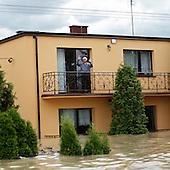 NOWY WIONCZENIN, POLAND, MAY 24, 2010:.Villager in a flooded house..The latest chapter of disastrous floods in Poland has been opened yesterday, May 23, 2010, after Vistula river broke its banks and flooded over 25 villages causing evacualtion of most inhabitants..Photo by Piotr Malecki / Napo Images..NOWY WIONCZENIN, POLSKA, 24/05/2010:.Mieszkancy w zatopionym domu.  Najnowszy akt straszliwych tegorocznych powodzi zostal rozpoczety wczoraj gdy Wisla przerwala waly na wysokosci wsi Swiniary kolo Plocka..Fot: Piotr Malecki / Napo Images ..
