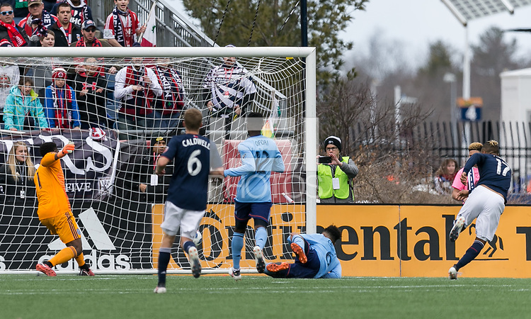 Foxborough, Massachusetts - March 24, 2018: In a Major League Soccer (MLS) match, New England Revolution (blue/white) tied New York City FC (NYCFC) (light blue/blue), 2-2, at Gillette Stadium.<br /> Goal.