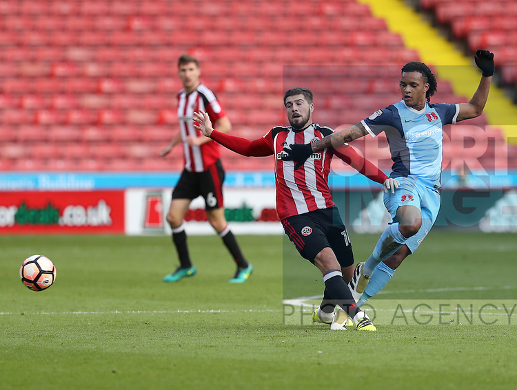 Sandro Semedo of Leyton Orient  tussles with Kieron Freeman of Sheffield United during the Emirates FA Cup Round One match at Bramall Lane Stadium, Sheffield. Picture date: November 6th, 2016. Pic Simon Bellis/Sportimage