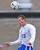 North Babylon No. 23 Matt Muller goes up for a header during a Suffolk County varsity boys' soccer Class AA first round playoff game against Ward Melville at North Babylon High School on Tuesday, October 27, 2015. Ward Melville won by a score of 1-0.<br /> <br /> James Escher