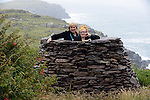 26-7-2015: Weather Humphreys?.....  Minister for Arts, Heritage and the Gaeltacht Heather Humphreys pictured in an old traditional rock cairn with Noelle Campbell-Sharpe during their visit to the Cill Rialaigh Famine Village in South Kerry on Sunday. Minister Humphreys also visited Ballinskelligs overlooking the Skellig Rocks where filming of the next episode of Star Wars is expected to begin this September.<br /> Picture by Don MacMonagle