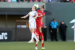 19 June 2015: Kansas City's Liz Bogus (left) and Portland's Sinead Farrelly (right) challenge for a header. The Portland Thorns FC hosted FC Kansas City at Providence Park in Portland, Oregon in a National Women's Soccer League 2015 regular season match. The game ended in a 1-1 tie.