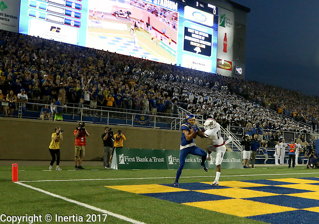 BROOKINGS, SD - AUGUST 31: Jake Wieneke #19 from South Dakota State University hauls in a touchdown pass in front of Abner Roberts #11 from Duquesne in the first half of their game Thursday night at Dana J. Dykhouse Stadium in Brookings. (Photo by Dave Eggen/Inertia)