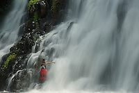 Local girls from Micronesia enjoying one of the many waterfalls on the Island of Pohnpei, Micronesia