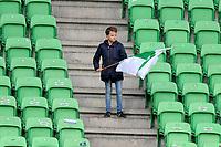 GRONINGEN - Voetbal, FC Groningen - Preussen Munster  oefenwedstrijd , Noordlease stadion, seizoen 2017-2018, 08-11-2017,   eenzame fan met vlag