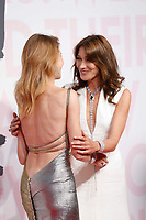 Natalia Vodianova and Carla Bruni attend Fashion for Relief Cannes 2018 during the 71st annual Cannes Film Festival at Aeroport Cannes Mandelieu on May 13, 2018 in Cannes, France.<br /> CAP/GOL<br /> &copy;GOL/Capital Pictures