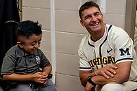 Michigan Wolverines head coach Erik Bakich answers questions from Matt Medina from Houston after the NCAA College World Series Finals press conference on June 23, 2019 at TD Ameritrade Park in Omaha, Nebraska. Michigan will play Vanderbilt in the CWS Finals. (Andrew Woolley/Four Seam Images)