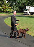 28 October 2016 - File Photo: United States President Bill Clinton and his dog, Buddy, depart the White House in Washington, DC en route to the family vacation on Martha's Vineyard, Massachusetts on Thursday, August 19, 1999.  On Tuesday, August 17, 1999, the President testified before the Grand Jury on his involvement in the Monica Lewinsky scandal and subsequently made a nationally televised statement admitting he had an inappropriate relationship with Ms. Lewinsky. Photo Credit: Ron Sachs/CNP/AdMedia