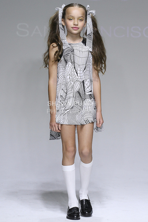 Young model walks runway in an outfit from the Alivia Simone Spring Summer 2015 collection by Shirley Newton and Simone Colbert, at petitePARADE Spring Summer 2015, during Kids Fashion Week in New York City, on October 18, 2014.