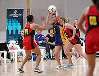 05.10.2012 Eastern's Candis Cardie in action during the netball match between Tasman and Eastern at the Lion Foundation Netball Champs in Tauranga. Mandatory Photo Credit ©Michael Bradley.