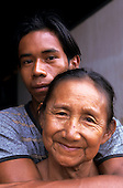 Altamira, Amazon, Brazil. Brazil nut oil factory; Dona Xipaya and her son Tatu.
