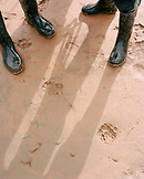 PERU, Amazon Rainforest, South America, Latin America, high angle view of human legs by footprints