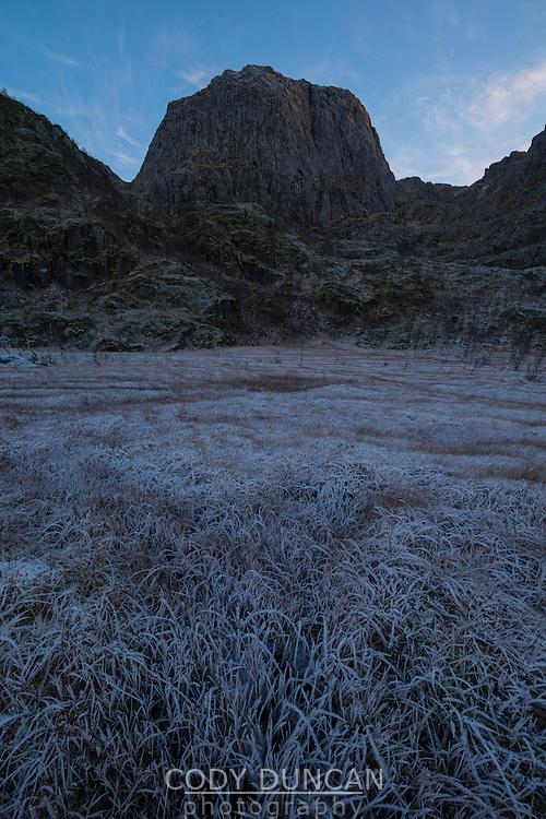 Reka mountain peak rises over frozen bogland, Vesterålen, Norway
