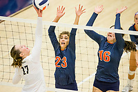 NWA Democrat-Gazette/BEN GOFF @NWABENGOFF<br /> Emerson Traweek (17) of Bentonville West hits the ball into the block of Kariann Haney (23) and Yanisbeth Sanchez of Rogers Heritage in the 2nd set Thursday, Sept. 13, 2018, at War Eagle Arena in Rogers.
