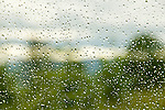Water dropplets on glass with scenic background