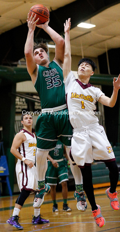 Waterbury, CT- 09 January 2016-010916CM02- Chase Collegiate's Drew Barbeau, left, goes to the hoop against MacDuffie's Simon Shi during their prep school matchup in Waterbury on Saturday.    Christopher Massa Republican-American