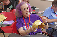 New York, NY, USA - June 24-25, 2017: OrigamiUSA 2017 Convention at St. John's University, Queens, New York, USA. The Challenge: Mark Bolitho teaches  his model Icosahedron. The model looks simple but requires a talented hand and a bit of luck to complete.
