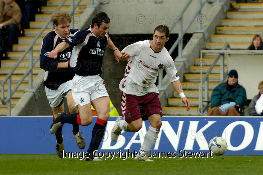 25/03/2006         Copyright Pic: James Stewart.File Name : sct_jspa28_falkirk_v_hearts.RUDOLF SKACEL HOLDS OFF JACK ROSS AND KARL DODD....Payments to :.James Stewart Photo Agency 19 Carronlea Drive, Falkirk. FK2 8DN      Vat Reg No. 607 6932 25.Office     : +44 (0)1324 570906     .Mobile   : +44 (0)7721 416997.Fax         : +44 (0)1324 570906.E-mail  :  jim@jspa.co.uk.If you require further information then contact Jim Stewart on any of the numbers above.........