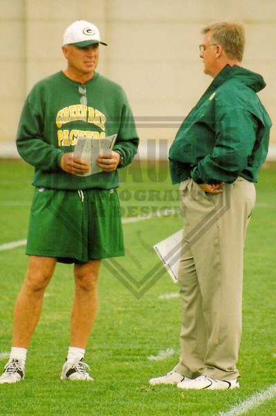 GREEN BAY - AUGUST 2002: Mike Sherman (right) talks with Tom Rossley of the Green Bay Packers during a Training Camp practice in August 2002 in Green Bay, Wisconsin. (Photo by Brad Krause)