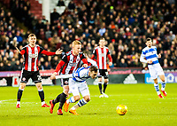 Sheffield United's midfielder Mark Duffy (21) fouls Queens Park Rangers midfielder Josh Scowen (11) during the Sky Bet Championship match between Sheff United and Queens Park Rangers at Bramall Lane, Sheffield, England on 20 February 2018. Photo by Stephen Buckley / PRiME Media Images.