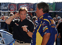 Nov 13, 2005; Phoenix, Ariz, USA;  Nascar driver Kenny Wallace talks with Jimmy Fenning, crew chief of the #97 Irwin Ford of Jack Roush Racing after 2004 Nextel Cup Champion Kurt Busch was pulled from the car for the remainder of the season after being arrested for wreckless driving Friday night in nearby Avondale, Ariz. Wallace was notified hours before the race that he would be driving in the Checker Auto Parts 500 at Phoenix International Raceway. Mandatory Credit: Photo By Mark J. Rebilas