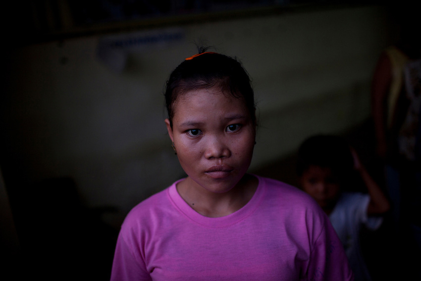 A 16-year-old domestic migrant worker is seen at an SKMM Investment Group training centre in Russey Keo district, Phnom Penh, October 19, 2011. The recruitment firm, which sends Cambodian maids to Malaysia for placement, was raided the following day. More than 70 women, including a number of underage girls, were freed from the company's three training centers in Phnom Penh. According to Cambodian law, domestic workers must be at least 21 years of age to travel to Malaysia to work as maids, however some of the recruits who were as young as 15 and 16 and stated that the company had falsified travel documents to bypass the rules.