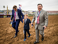 DEL MAR, CA - NOVEMBER 03:  Toby Moore, son of jockey Ryan Moore walk on the track after his father wins the Sentient Jet Breeders' Cup Juvenile at Del Mar Thoroughbred Club on November 03, 2017 in Del Mar, California. (Photo by Alex Evers/Eclipse Sportswire/Breeders Cup)