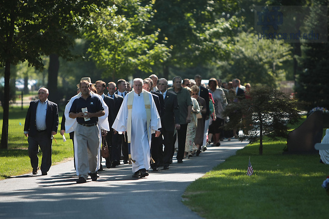 Guests walk from the chapel to the new crypts in Cedar Grove Cemetery for the dedication and blessing of Our Lady of Sorrows at Cedar Grove Cemetery.