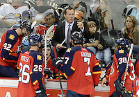 Florida Panthers head coach Kevin Dineen talks to his players during the third period of an NHL preseason hockey game against the Dallas Stars, Friday, Sept. 20, 2013, in San Antonio, Texas. Dallas won 4-1. (Darren Abate/DA Media)