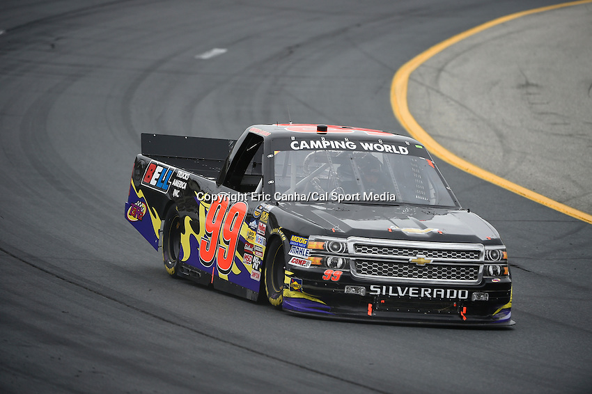 September 19, 2014 - Loudon, New Hampshire, U.S. -  Bryan Silas, NASCAR Camping World Truck Series driver of the #99 Chevy truck heads into turn 2 during the NASCAR Camping World Truck Series UNOH 175 race held at the New Hampshire Motor Speedway in Loudon, New Hampshire.   Eric Canha/CSM