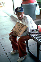 "Homeless man age 45 begging with sign ""please help hungry"".  Washington DC USA"