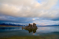 A lone Mono Lake tufa under the sky of an approaching storm