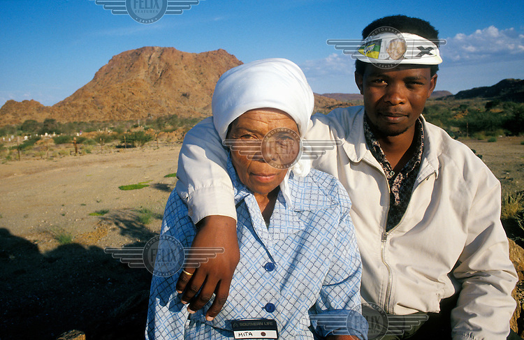 An elderly woman and her son, members of the Riemvasmaak community who were removed from their ancestral land during the time of apartheid, and sent to Namibia and the Eastern Cape. In 1995, following the victory of Nelson Mandela and the ANC in the country's first multiracial election, they returned to start their lives again.