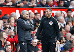 Jose Mourinho manager of Manchester United laughs with the fourth official during the English Premier League match at Old Trafford Stadium, Manchester. Picture date: April 16th 2017. Pic credit should read: Simon Bellis/Sportimage