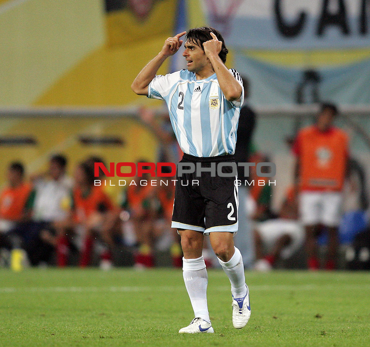 FIFA WM 2006 - Round Of Sixteen / Achtelfinale<br /> <br /> Play #50 (24-Jun) - Argentina vs Mexico.<br /> <br /> Roberto Ayala from Argentina celebrates during the match of the World Cup in Leipzig. Argentina leads by 2-1 goal during extra time.<br /> <br /> Foto &copy; nordphoto